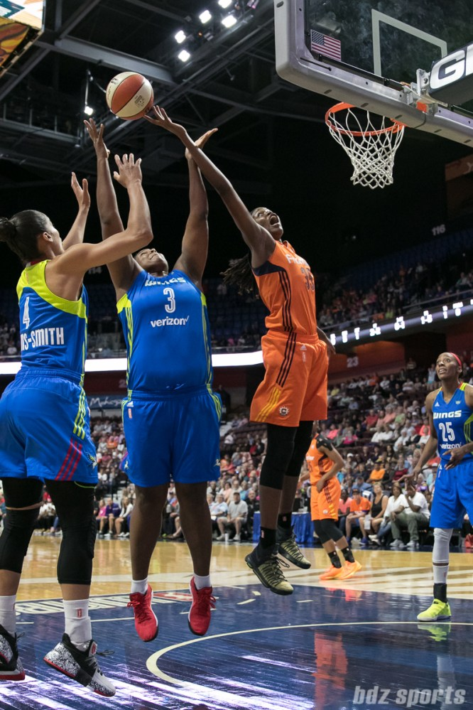Dallas Wings center Courtney Paris (3) and Connecticut Sun center Jonquel Jones (35) look to grab the rebound.