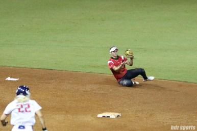 Scrap Yard Dawgs shortstop Ali Aguilar (11) slides to make the grab