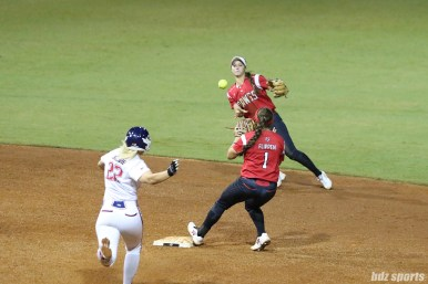 Scrap Yard Dawgs shortstop Ali Aguilar (11) throws the ball to second baseman Hannah Flippen (1) for the force out