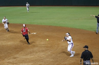 USSSA Pride second baseman Sierra Romero (32) throws the ball to first for the out