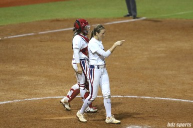 USSSA Pride pitcher Jolene Henderson (54) points to a teammate after she gets the out