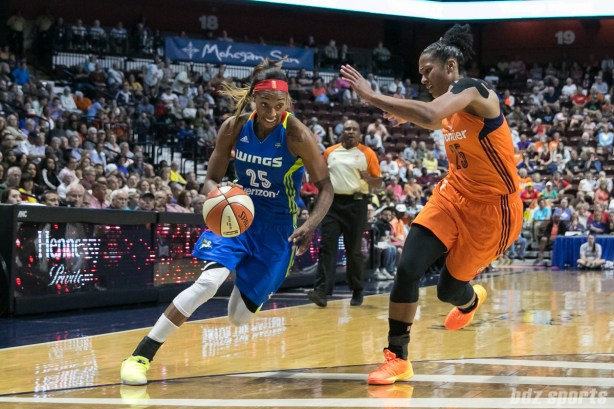 Dallas Wings forward Glory Johnson (25) drives to the basket while being defended by Connecticut Sun forward Alyssa Thomas (25).