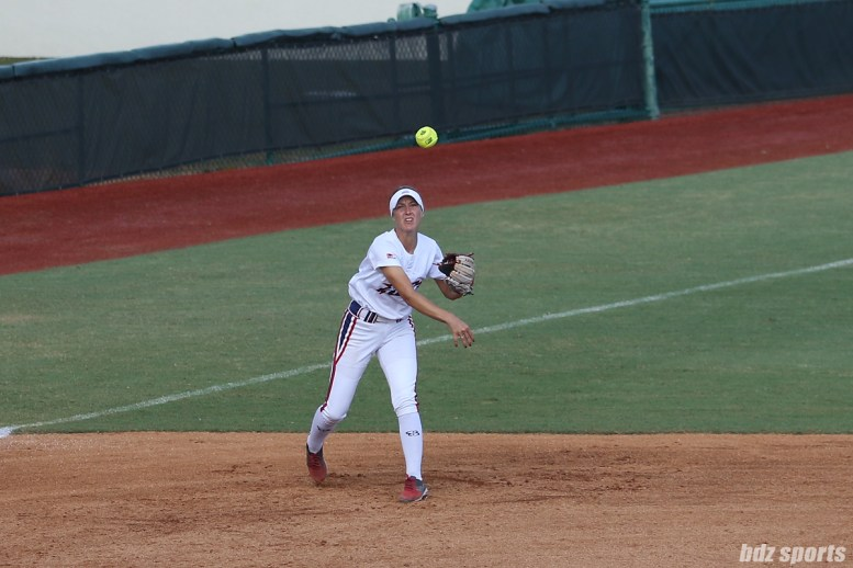 USSSA Pride infielder Courtney Ceo (6) makes a throw to first base