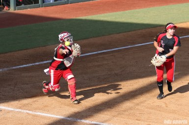 Scrap Yard Dawgs catcher Taylor Edwards (25) makes a throw to first base