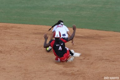 Scrap Yard Dawgs pinch runner Olivia Watkins (4) slides and is safe after stealing second base