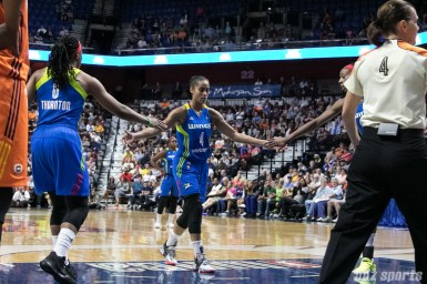 Dallas Wings forward Kayla Thornton (6) high fives teammate guard Skylar Diggins-Smith (4).