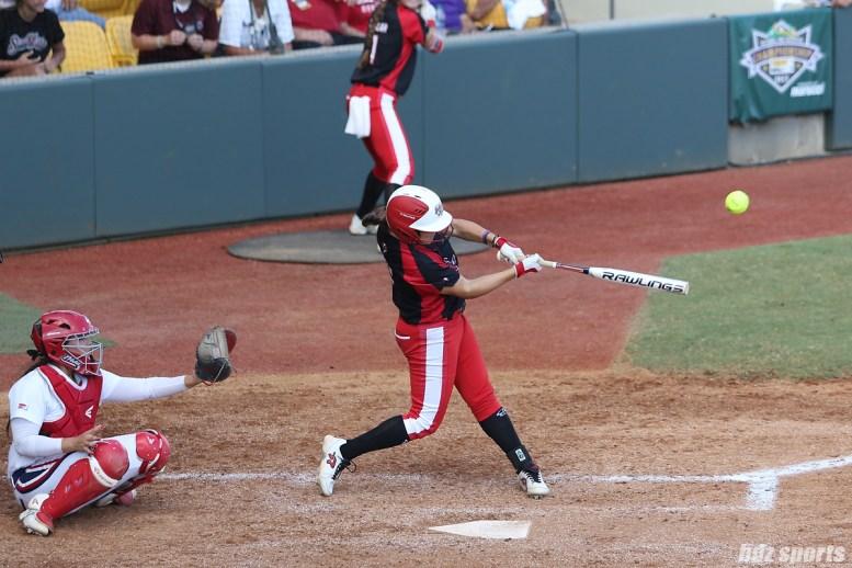 Scrap Yard Dawgs second baseman Hannah Flippen (1) makes contact with the ball
