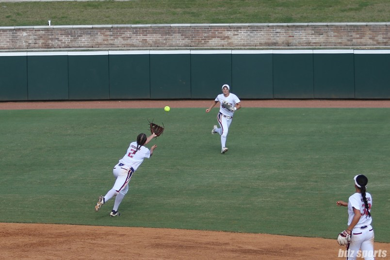The ball falls just beyond the reach of USSSA Pride shortstop Shelby Pendley (2)