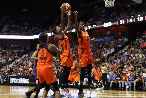 Connecticut Sun guard Courtney Williams (10) grabs the rebound for the Sun