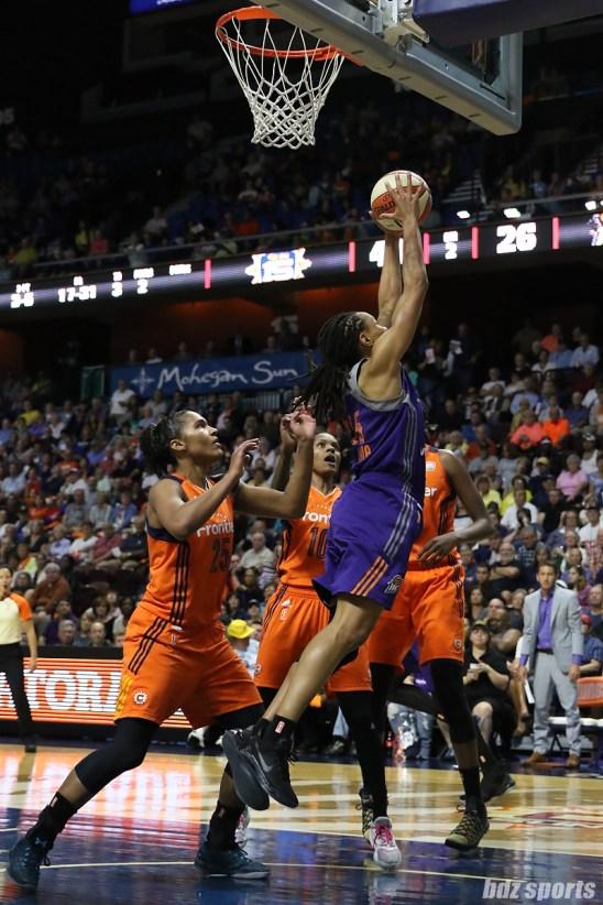 Phoenix Mercury guard Monique Currie (25) grabs the rebound