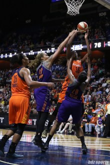 Connecticut Sun center Jonquel Jones (35) goes to the basket while being defended by Phoenix Mercury players Brittney Griner (42) and Camille Little (20)