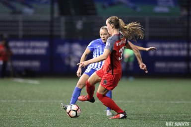 Portland Thorns FC midfielder Celeste Boureille (30) controls the ball for the Thorns as Boston Breakers forward Adriana Leon (19) challenges