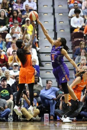 Phoenix Mercury guard Monique Currie (25) blocks the shot from Connecticut Sun guard Courtney Williams (10)