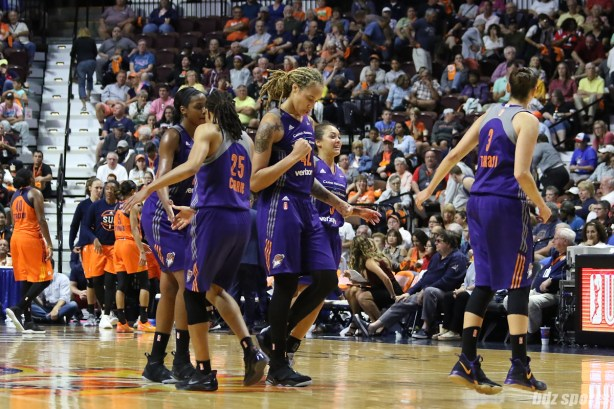 Phoenix Mercury center Brittney Griner (42) gives a fist pump during a timeout