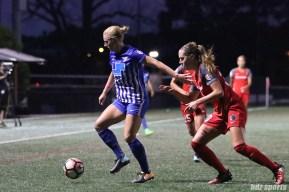 Boston Breakers forward Natasha Dowie (9) shields the ball from Portland Thorns FC midfielder Celeste Boureille (30)