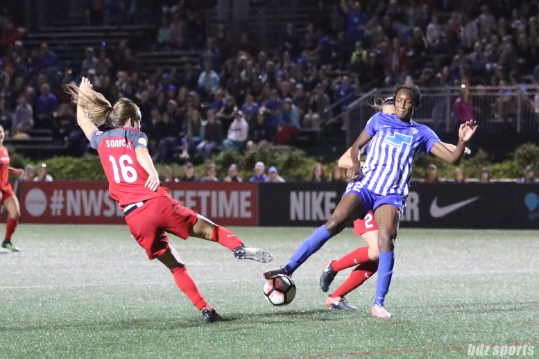 Portland Thorns FC defender Emily Sonnett (16) challenges Boston Breakers forward Ifeoma Onumonu (22) for the ball