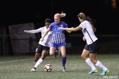 Boston Breakers defender Megan Oyster (4) controls the ball for the Breakers while being pressured by two Sky Blue FC players