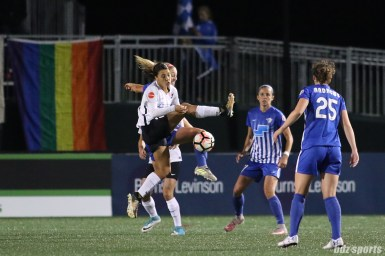 Sky Blue FC forward Sam Kerr (20) challenges Boston Breakers defender Megan Oyster (4) for the ball