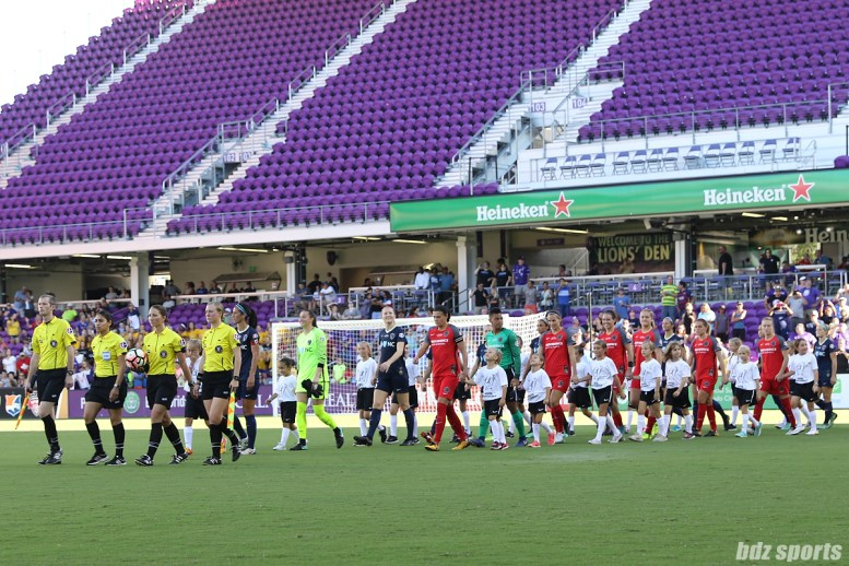 The starting XI for the North Carolina Courage and Portland Thorns FC enter the field