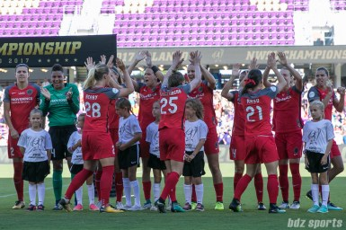 The Portland Thorns FC starting XI high five as they line up