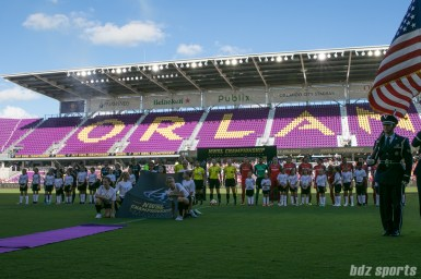 The North Carolina Courage and Portland Thorns FC line up for the playing of the national anthem