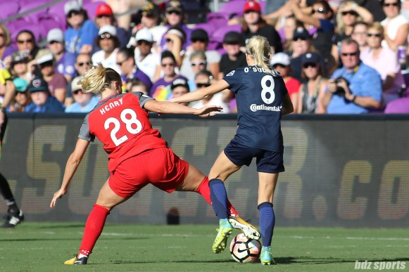 Portland Thorns FC midfielder Amandine Henry (28) battles North Carolina Courage midfielder Denise O'Sullivan (8) for the ball