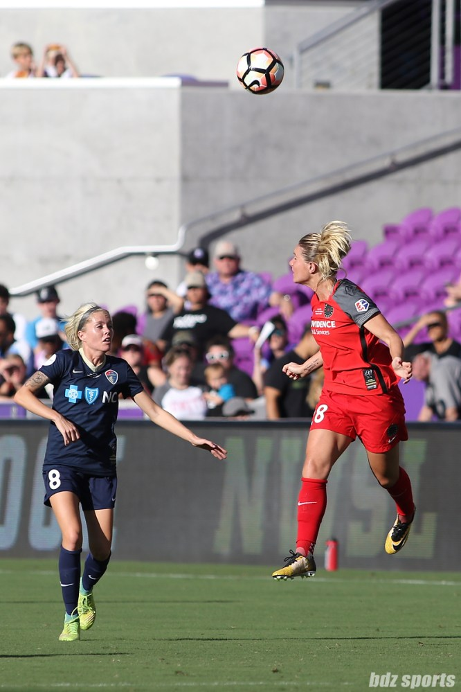 Portland Thorns FC midfielder Amandine Henry (28) heads the ball for the Thorns