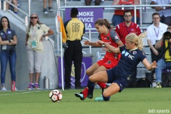 North Carolina Courage forward Makenzy Doniak (3) delivers a slide tackle on Portland Thorns FC midfielder Tobin Heath (17)
