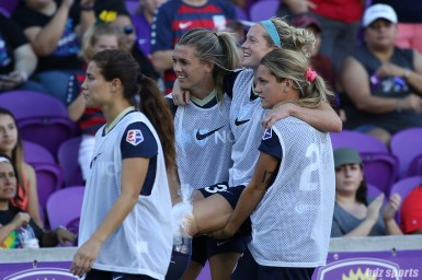 An injured North Carolina Courage forward Kristen Hamilton (23) gets carried off the field by teammates at half time