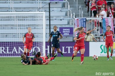 North Carolina Courage forward Lynn Williams (9) and Portland Thorns FC forward Hayley Raso (21) collide at midfield