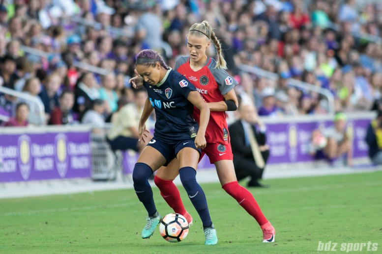 North Carolina Courage defender Jaelene Hinkle (15) shields the ball from Portland Thorns FC midfielder Dagny Brynjarsdottir (11)