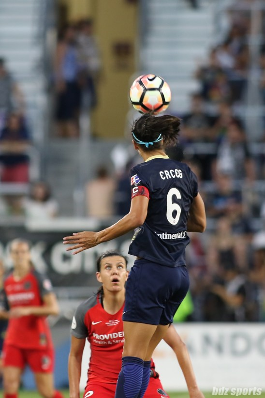 North Carolina Courage defender Abby Erceg (6) heads the ball away