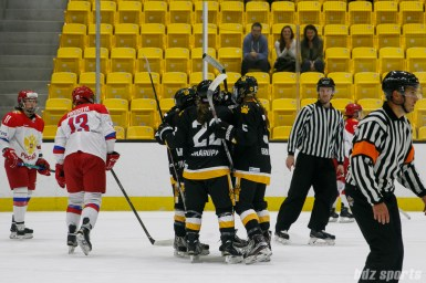 The Boston Pride celebrate Emily Field's (15) opening goal