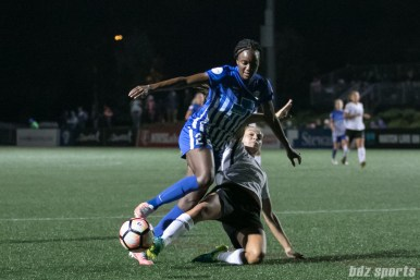 Sky Blue FC defender Erica Skroski (8) slide tackles the ball away from Boston Breakers forward Ifeoma Onumonu (22)