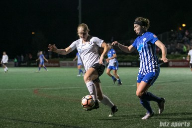 Sky Blue FC forward Leah Galton (21) dribbles the ball while being pressured by Boston Breakers midfielder Morgan Andrews (25)