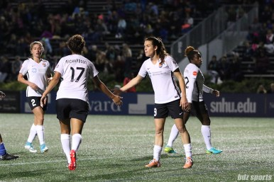 Sky Blue FC forward Kelley O'Hara (19) low fives teammate defender Domi Richardson (17)