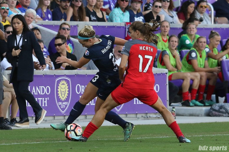 Portland Thorns FC midfielder Tobin Heath (17) challenges North Carolina Courage forward Kristen Hamilton (23) for the ball