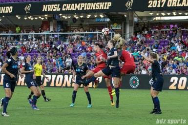 North Carolina Courage midfielder Sam Mewis (5) and Portland Thorns FC players Christine Sinclair (12) and Lindsey Horan (7) battle for the ball in the air