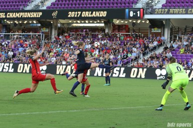 North Carolina Courage midfielder Sam Mewis (5) and Portland Thorns FC defender Emily Sonnett (16) battle for a loose ball in the box