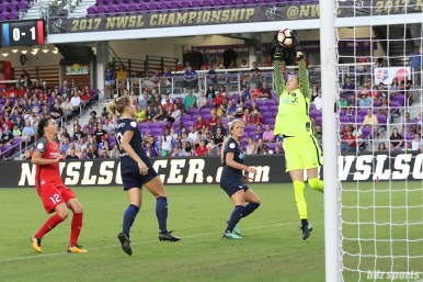 North Carolina Courage goalkeeper Katelyn Rowland (0) pulls down a crossed ball