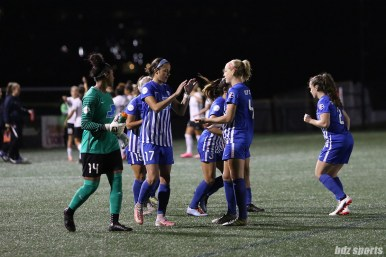 Boston Breakers defender Amanda Frisbie (17) slap hands with teammate Boston Breakers defender Megan Oyster (4) before the start of their game against the Sky Blue FC on September 30, 2017