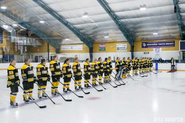 The Boston Blades line up for the playing of the national anthem