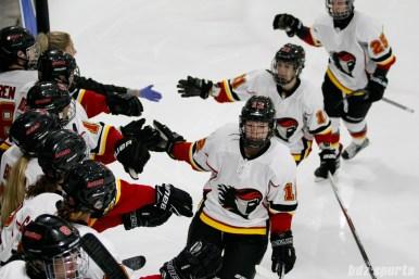 Calgary Inferno defender Taryn Baumgardt (12) high fives teammates after a goal