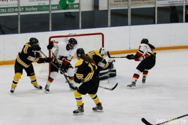 Boston Blades goalie Jetta Rackleff (21) looks to grab the puck