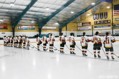 The Calgary Inferno line up for the playing of the national anthem
