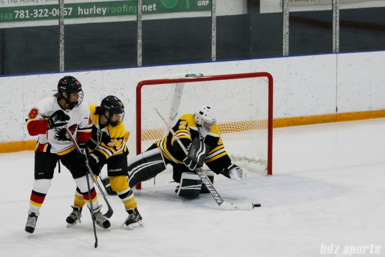 Boston Blades goalie Jetta Rackleff (21) looks to smother the puck