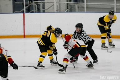 Boston Blades forward Casey Stathopoulos (12) takes the face off for the Blades