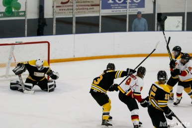 Boston Blades goalie Jetta Rackleff (21) comes up with the pad save