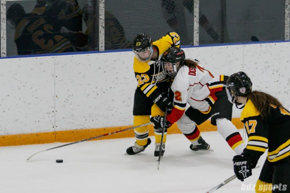 Boston Blades forward Melissa Bizzari (23) looks to fend off Calgary Inferno forward Laura Dostaler (2)