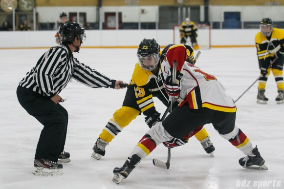Boston Blades forward Melissa Bizzari (23) faces off against Calgary Inferno forward Sophie Shirley (16)